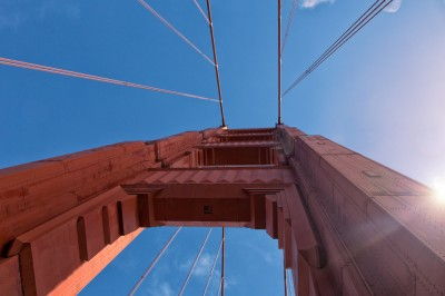 Golden Gate Bridge Tower Upward View - Sun Flare